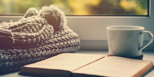 woolen-scarf-cup-tea-book-windowsill-hygge-cozy-autumn-concept_77190-2107